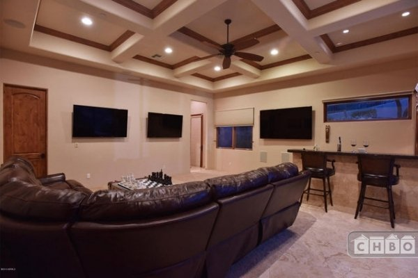 Recreation room includes full bar, wine cooler and ice maker