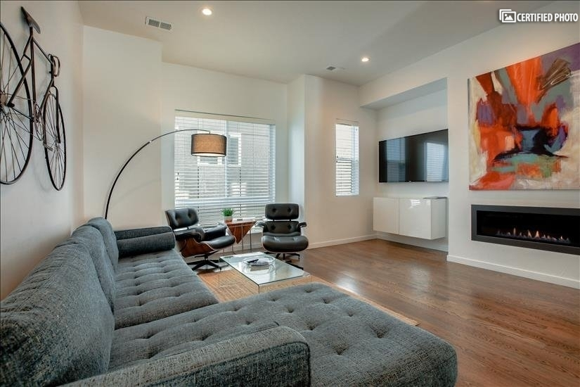 Spacious and comfortable main living area with gas fireplace