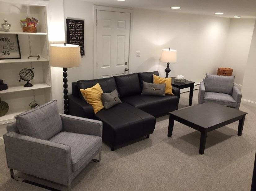 Living room with couch, chairs,  flat screen cable TV