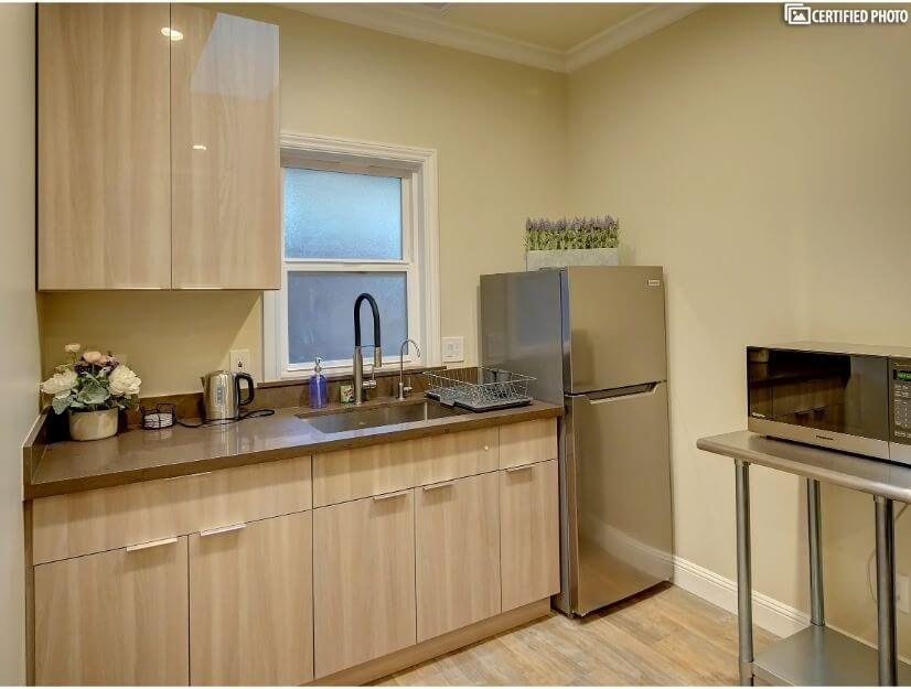 Suite D - Fully functional kitchenette w/ wet bar.