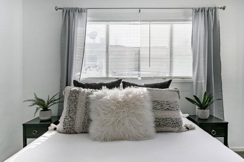 Bedroom with queen size memory foam bed, ceiling fan