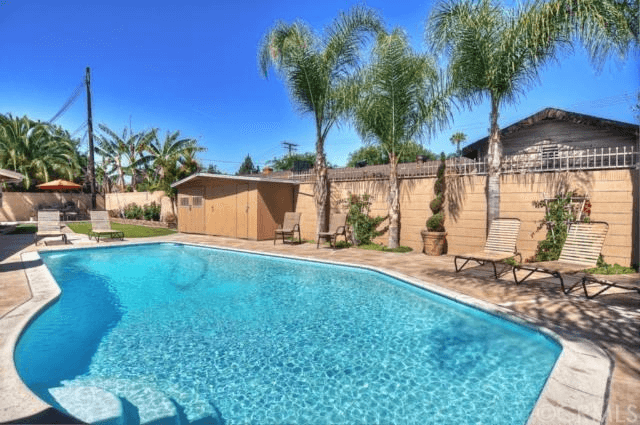 Sparkling swimming pool with pool shed filled