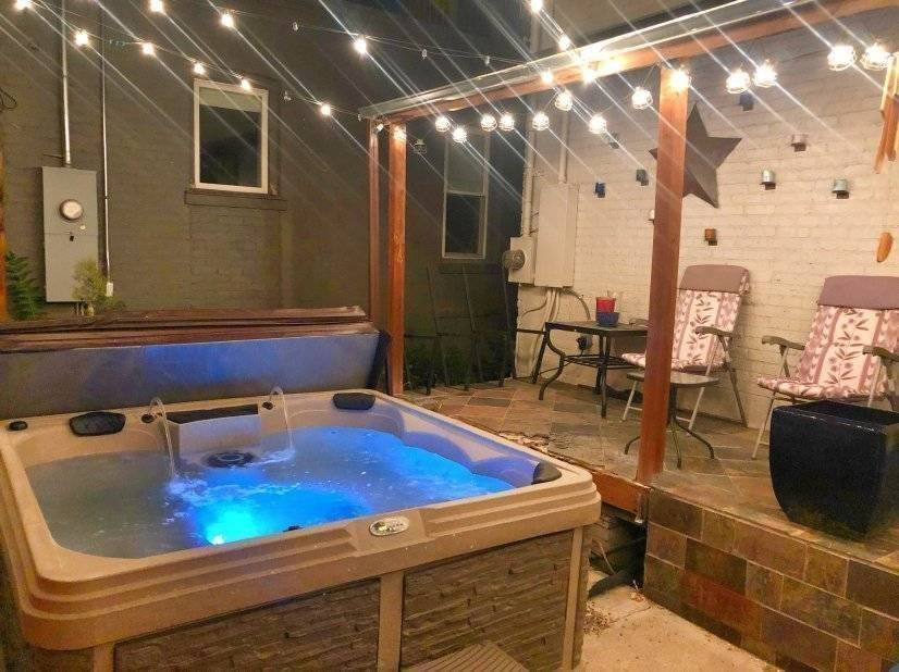 back yard hot tub with ferry lights