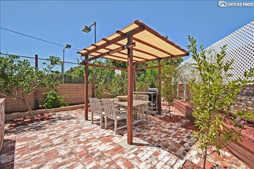 outdoor living space with gas and charcoal barbecues