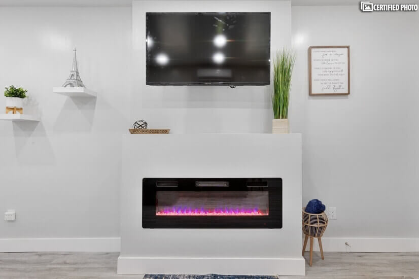 """Living room w/ 50"""" Smart TV and electric fireplace"""