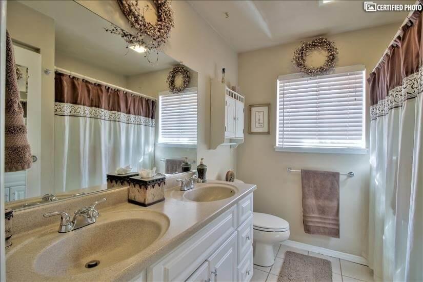 Hallway bathroom with shower, tub, double sinks