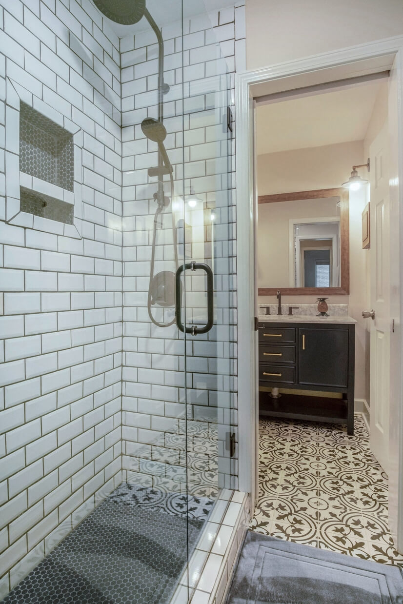 Walk In shower with sitting bench.
