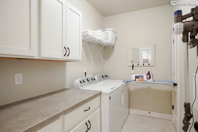 In-unit laundry with pull down ironing board & dyson vacuum
