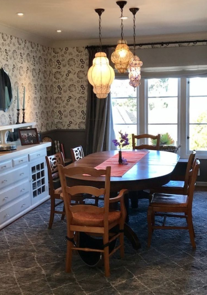 Dining room table expands to seat 12