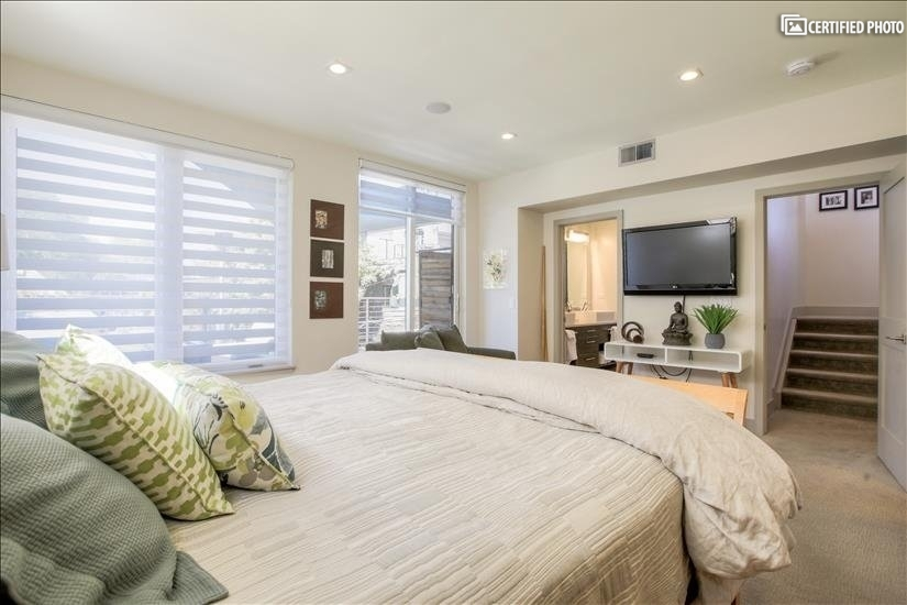 Master Bedroom with Large Screen TV and Overhead Speakers