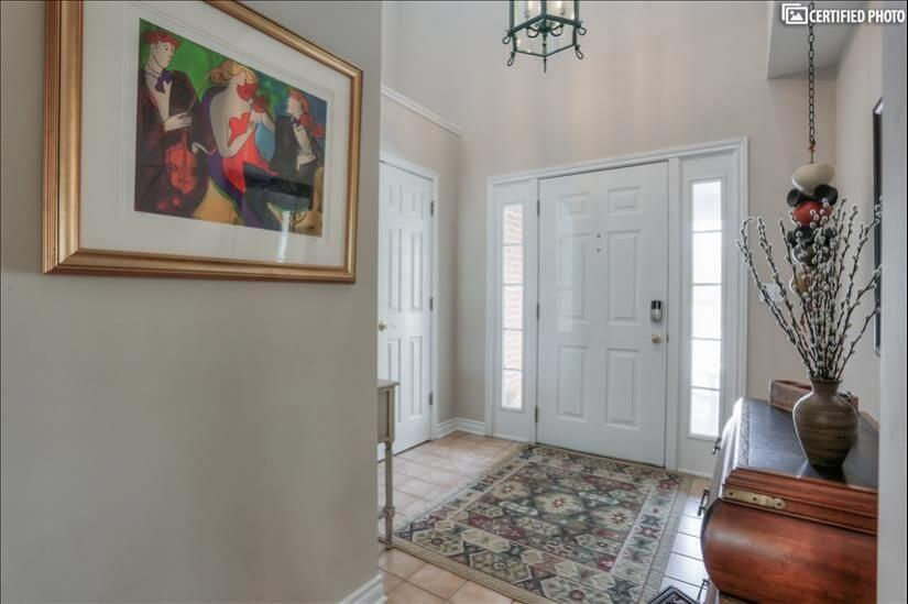 Interior front door entry. With large coat closet.