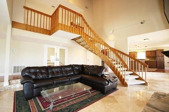 Oak stairway to top floor from second floor main living area