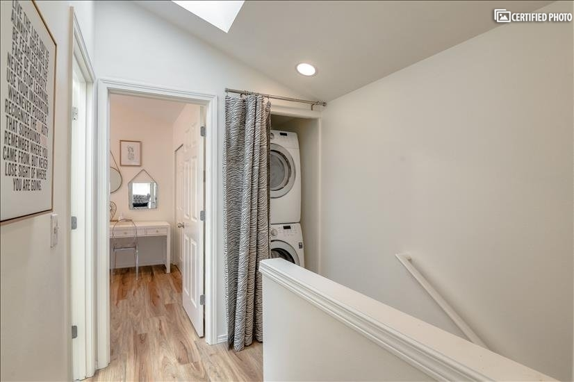 Hallway with laundry (washer & dryer)