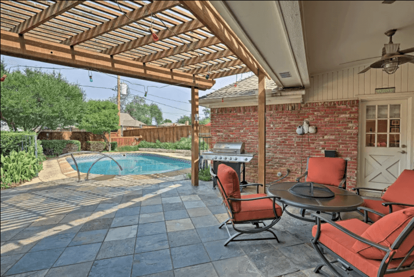 Master has a door that leads out to the patio and pool area.