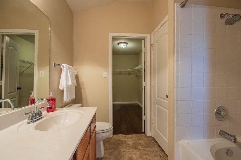 Master bathroom offer a garden tub/shower combination.