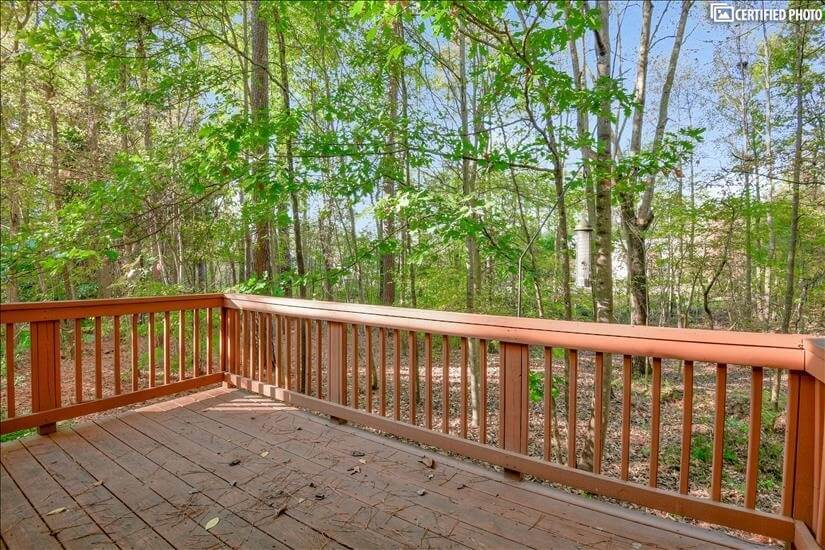 Back deck view of wooded lot
