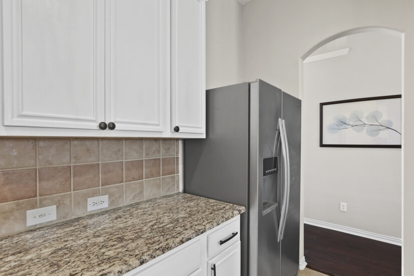 Granite Counters and stainless Fridge