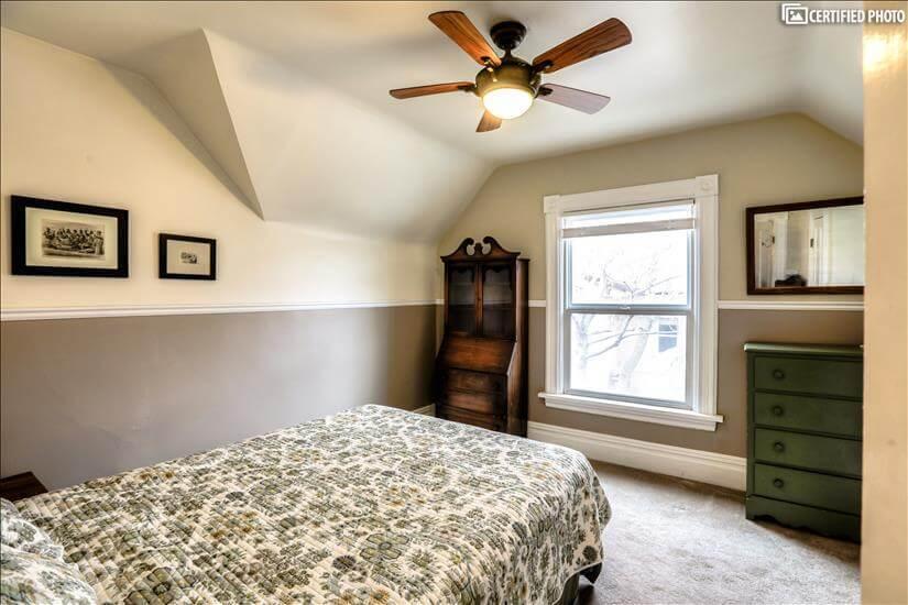 Second bedroom with Queen bed, desk, dresser.