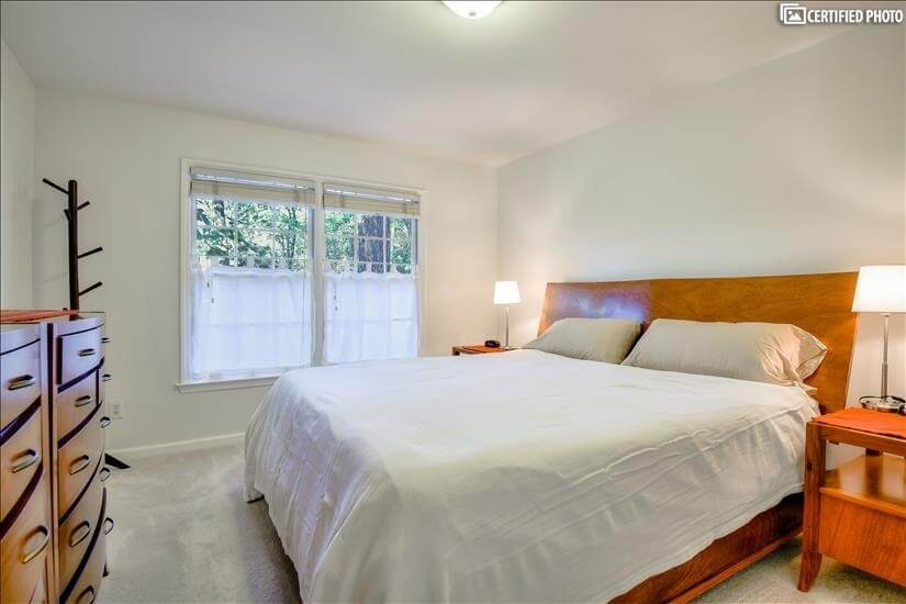 Bedroom is upstairs at back of house overlooking wooded lot