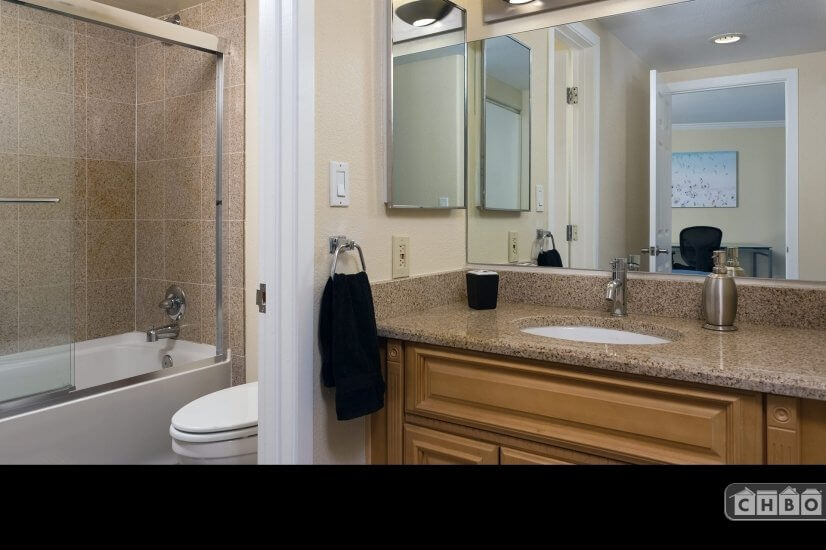 Bathroom and Vanity - Featuring Slab Granite