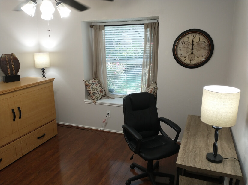 Guest bedroom with desk and window seat