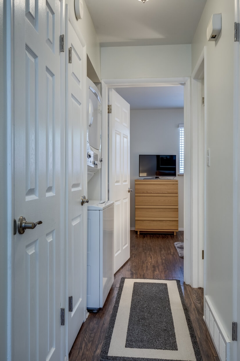 Hallway leading to bedrooms and bathroom