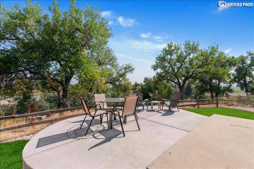 Private backyard patio with dining table & greenbelt views