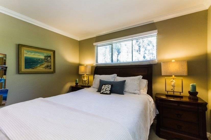 """Master Bedroom offers """"Coastal Retreat"""" decor, 2 nightstands"""