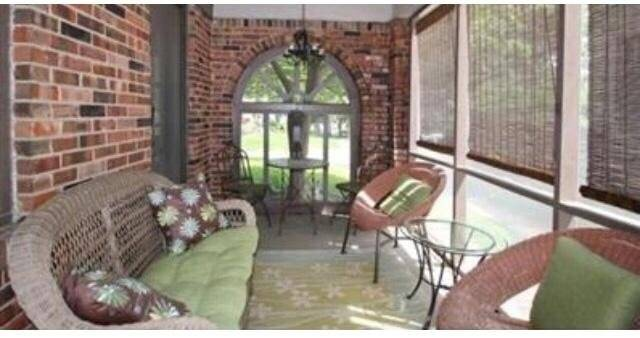 Sun porch, bricked and screened in.