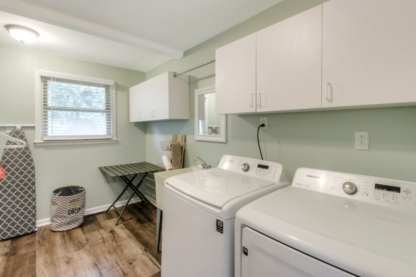 Huge laundry room with handy mud sink and folding table