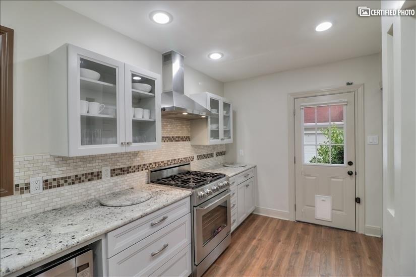 Kitchen - soft close cabinets by Kraftmaid; Granite counter