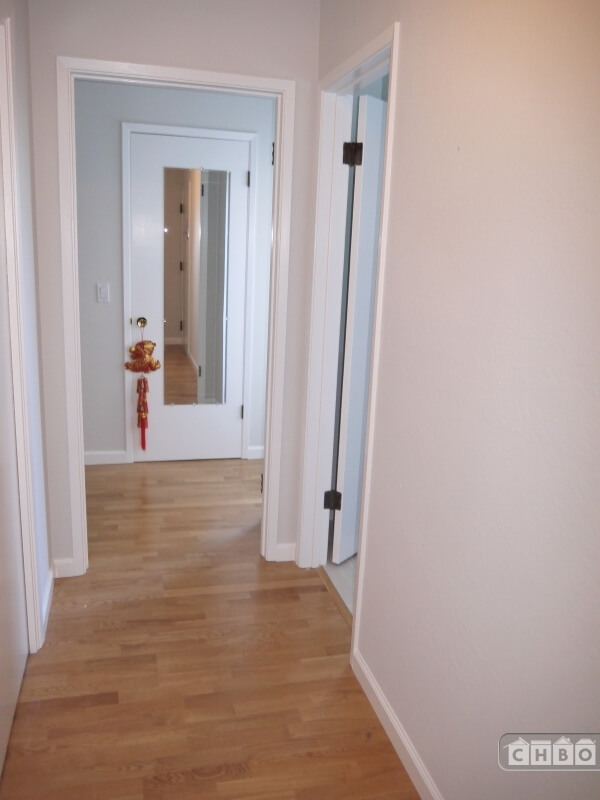 Hallway to bedroom and large walk-in closet