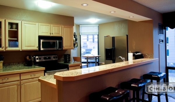 Kitchen With Bar and Stools