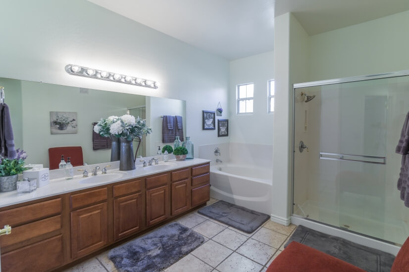 Master bath with double sink, bath, shower
