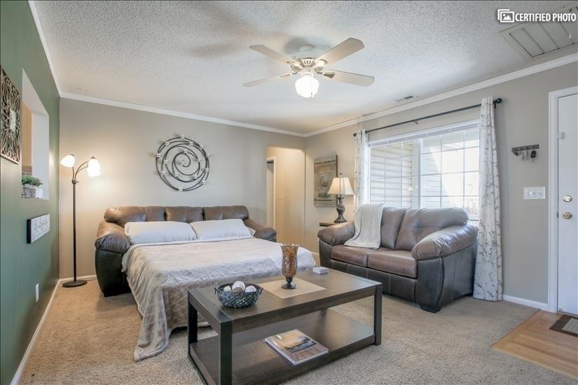 Full-sized mattress in leather sofa-sleeper