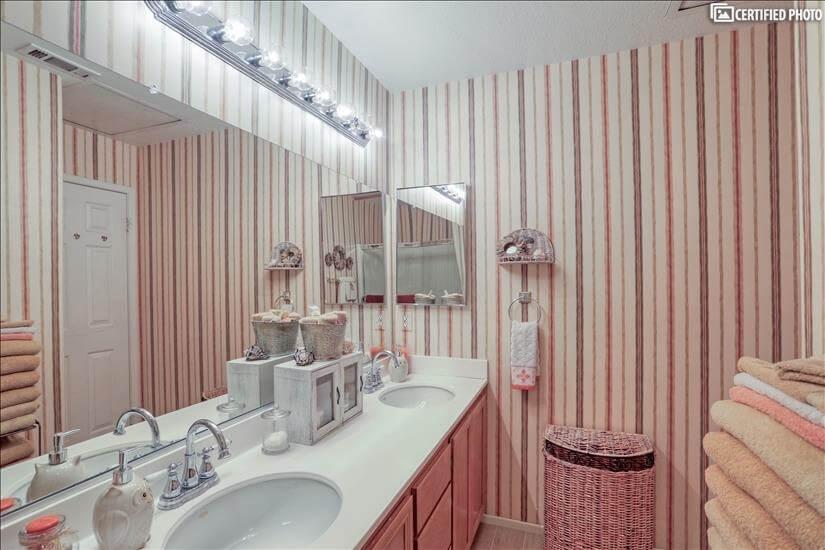 Upstairs bathroom with double sink vanity.