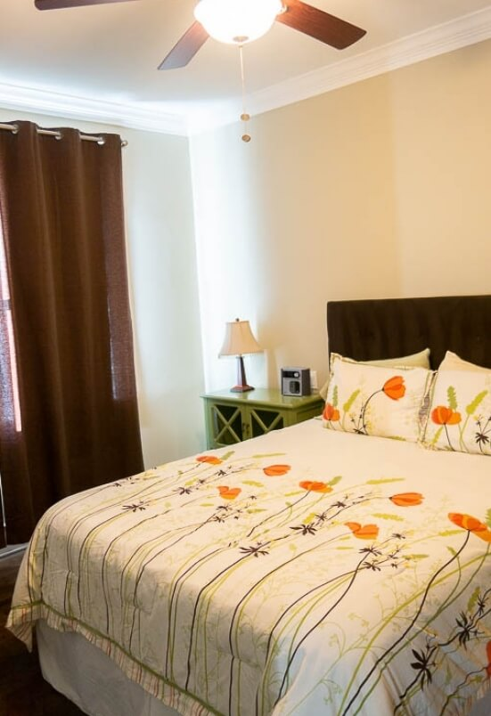 The main bedroom has a queen bed, dresser and giant closet.