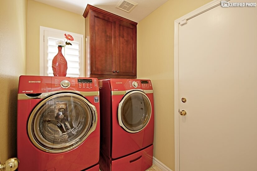Separate laundry room with high-end washer and dryer.
