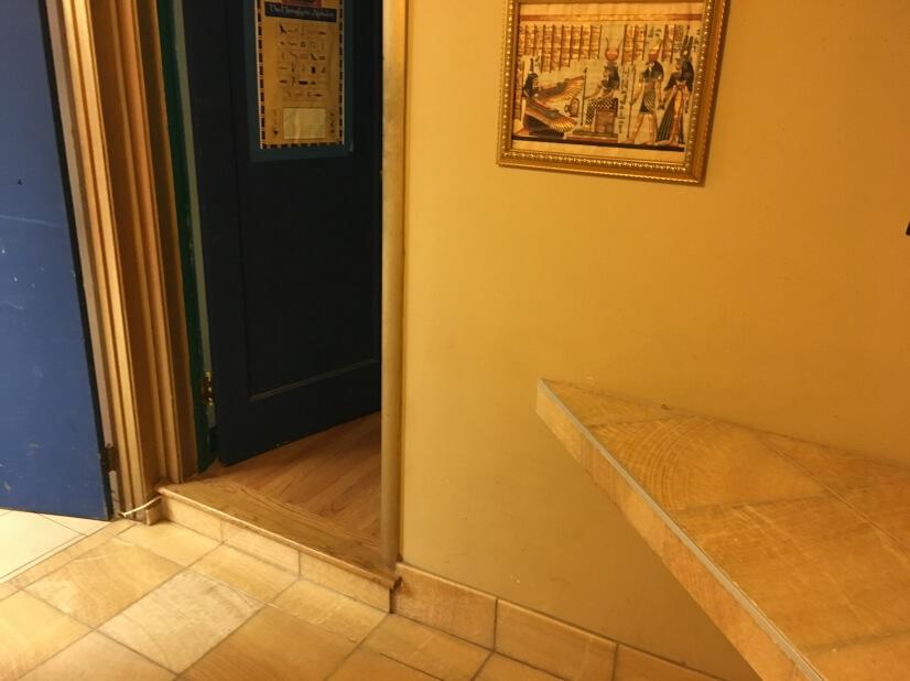 Foyer entryway btwn. front door and bedroom door