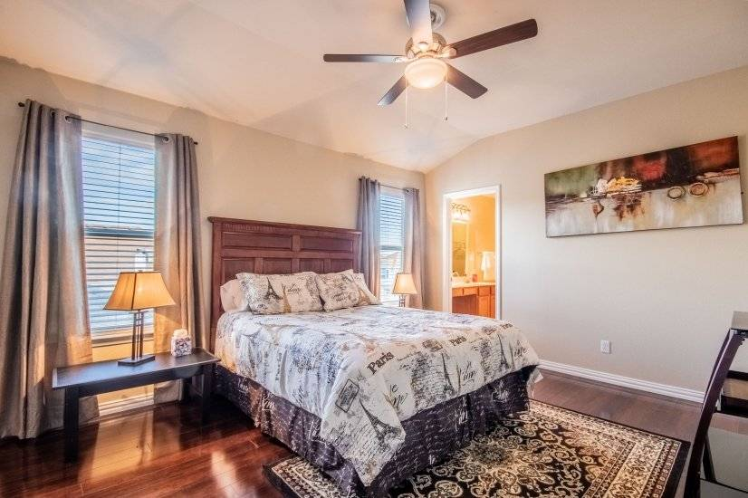 Master with queen size bed, private bath, and flat screen TV