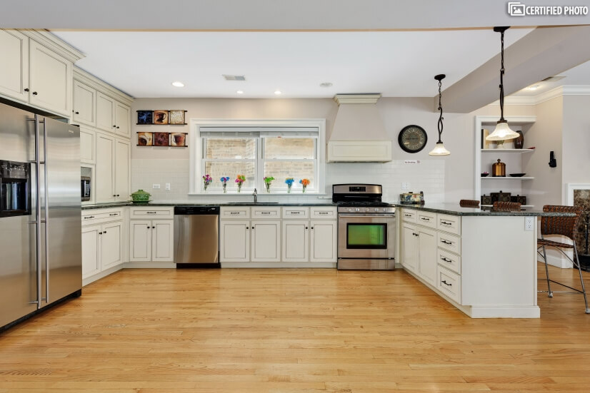 A wonderful kitchen to come home to with custom cabinets.