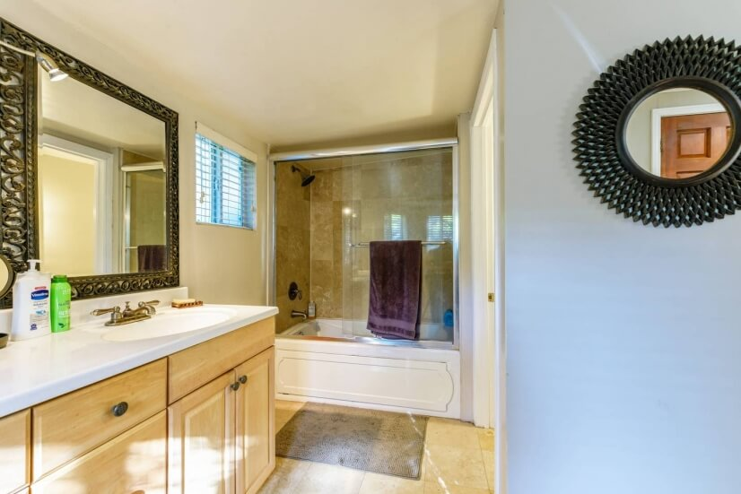 Master bathroom with double-sink vanity and tub/shower