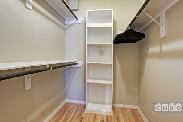 Large walk in closet with built-in.