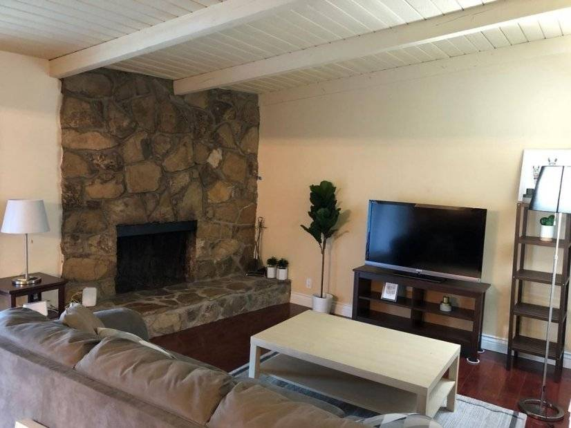 Living room with TV equipped with Firestick and Sling TV