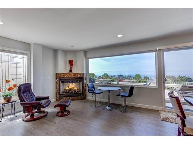 Open Living room with gas fireplace.