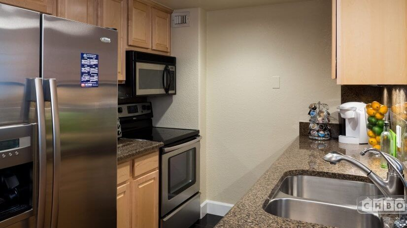 Kitchen - Featuring all stainless steel appliances, solid wo