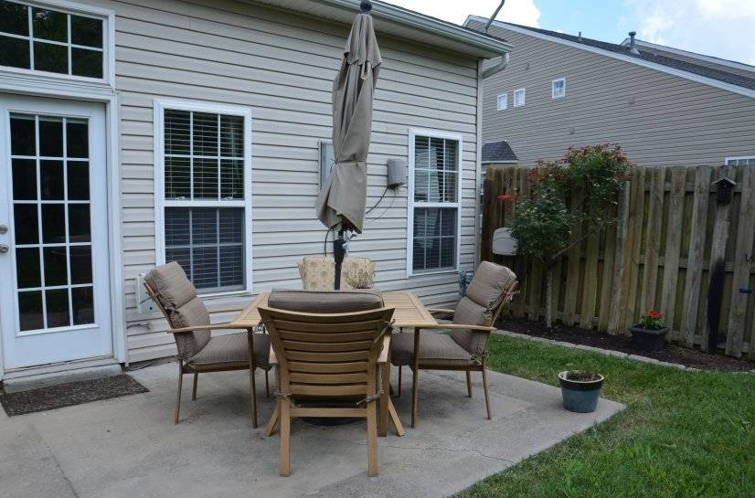 Private patio with outdoor speakers & raised garden