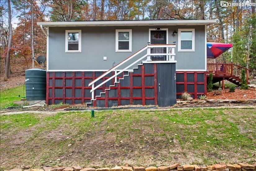 Small cabin with unique entry door.