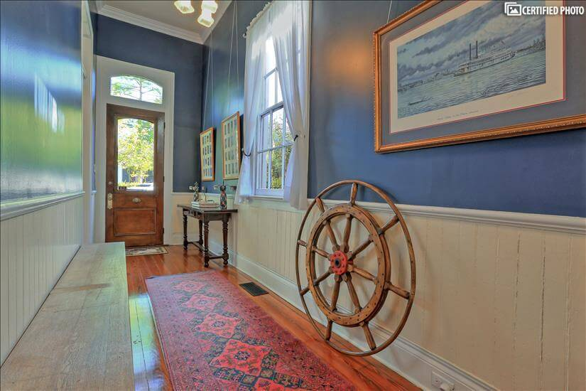 Side hall view to the front door with a nautical theme