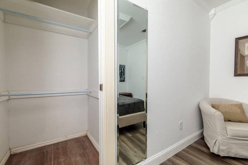 Bedroom closet with sliding pocket door.